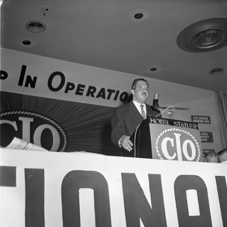 Thurgood Marshall of the National Association for the Advancement of Colored People (NAACP) stands at the podium