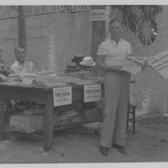 Photograph of men selling newspapers at Hindenburg Park