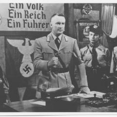 Photograph of men dressed in Nazi attire