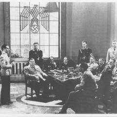 Film still of men in a room from Confessions of a Nazi Spy 3