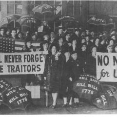 Photograph of people with signs titled We'll Never Forget the Traitors