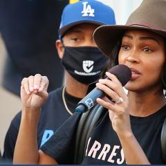 Woman speaks through handheld microphone