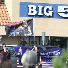 Demonstrators wave American and Trump flags
