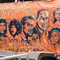 Banner featuring civil rights leaders and activists: RESIST OPPRESSION BLACK & BROWN