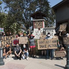 Masked protesters posing on a street corner with signs: NO JUSTICE, NO PEACE; IGNORING THIS IS PRIVILEGE; BLACK LIVES MATTER; a cop shot a BLACK WOMAN and was only charged for SHOTS MISSED; SILENCE IS VIOLENCE; DONT JUST HONK TAKE ACTION; DEFUND LASD; BREONNA deserved better