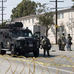 Armored vehicle with officers on the street