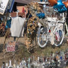 Memorial to Dijon Kizee with a bicycle, balloons, flowers and candles