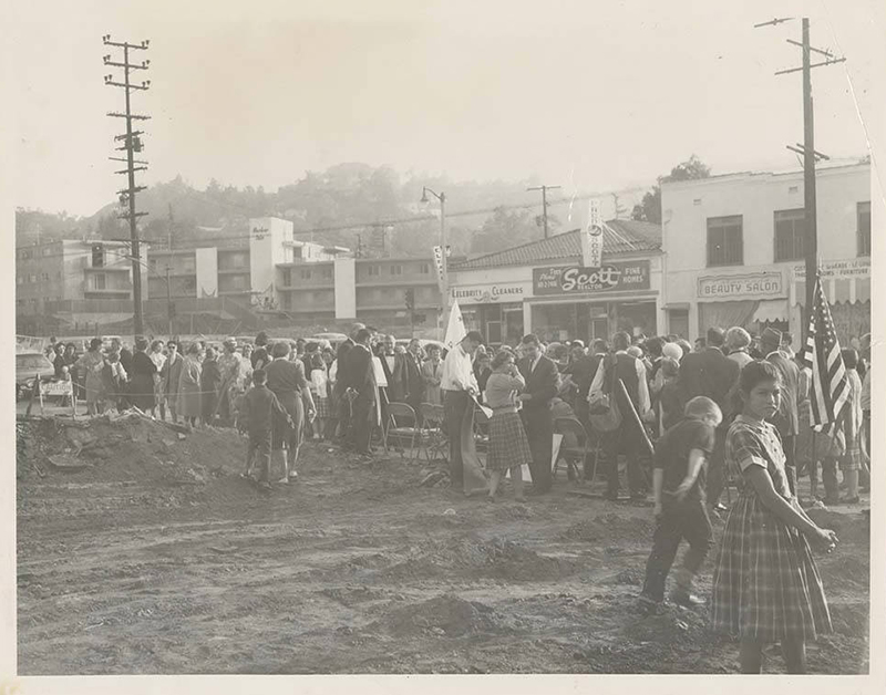 Photograph shows a crowd gathered for a ground breaking at the site of the future Campo de Cahuenga