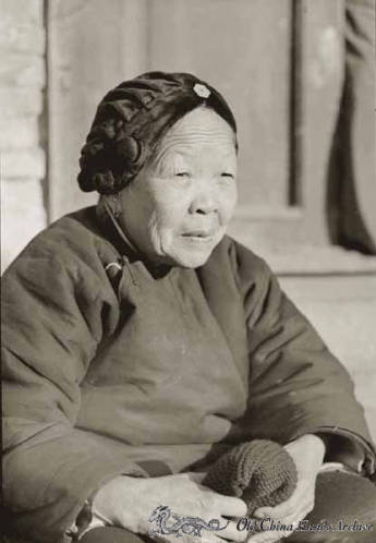 Elderly woman in Tientsin China, winter 1946