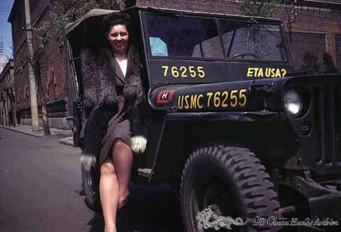 Ludmilla Luvdorski poses with military jeep